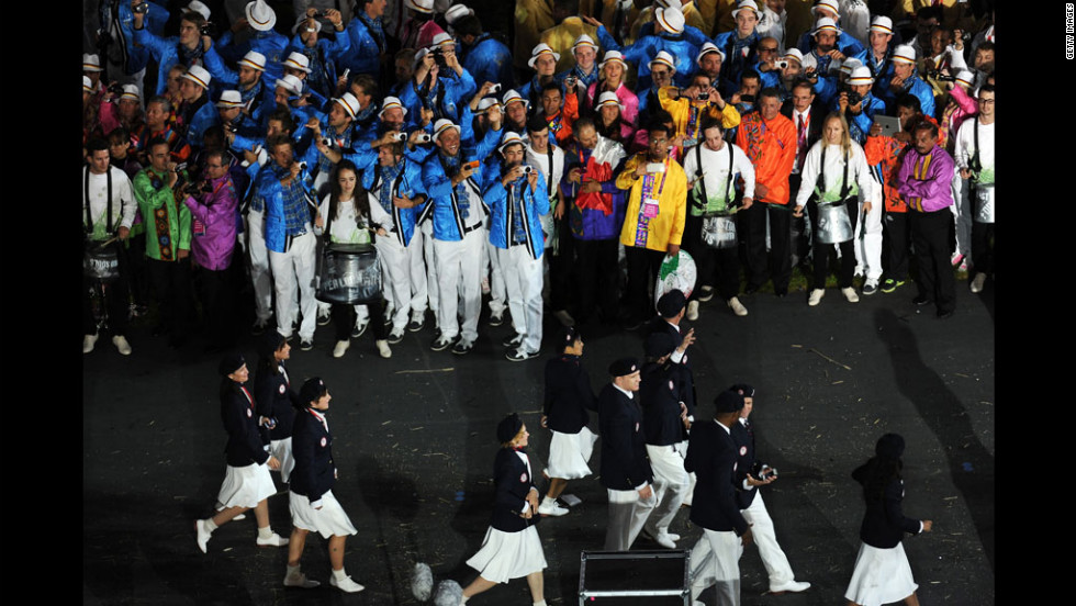 Team USA athletes parade around the track as athletes from other nations cheer, wave and take photos during Friday's opening ceremony.