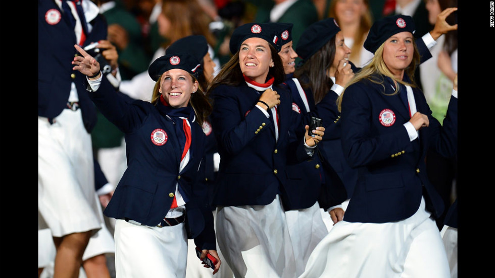 Team USA's men and women athletes wore Ralph Lauren-designed outfits featuring blue double-breasted blazers, white trousers or skirts, and blue berets.