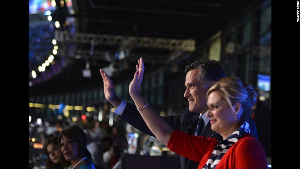 U.S. Republican presidential candidate Mitt Romney and his wife, Ann, wave during the opening ceremony.