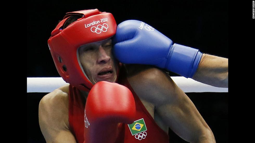 Robenilson Vieira de Jesus of Brazil absorbs a punch from Orzubek Shayimov of Uzbekistan during their match, which Vieira de Jesus won.