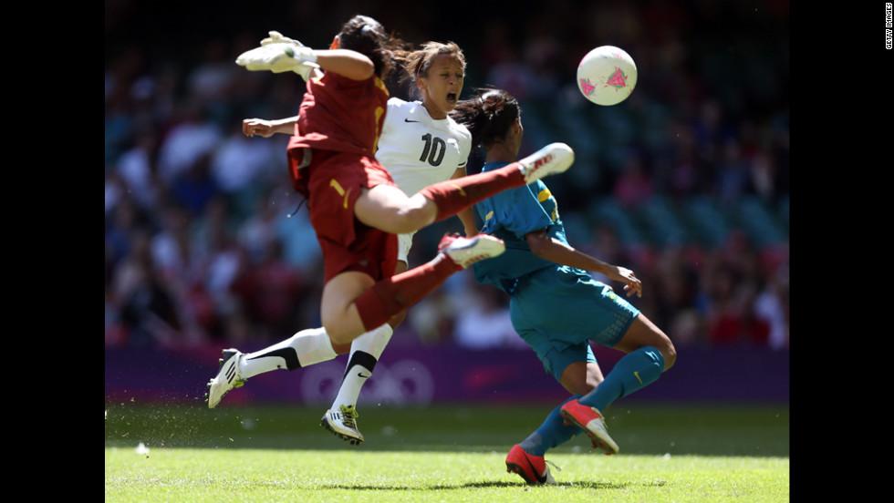 Goalkeeper Andreia Suntaque of Brazil tries to block a cross as Sarah Gregorius of New Zealand attempts a header.