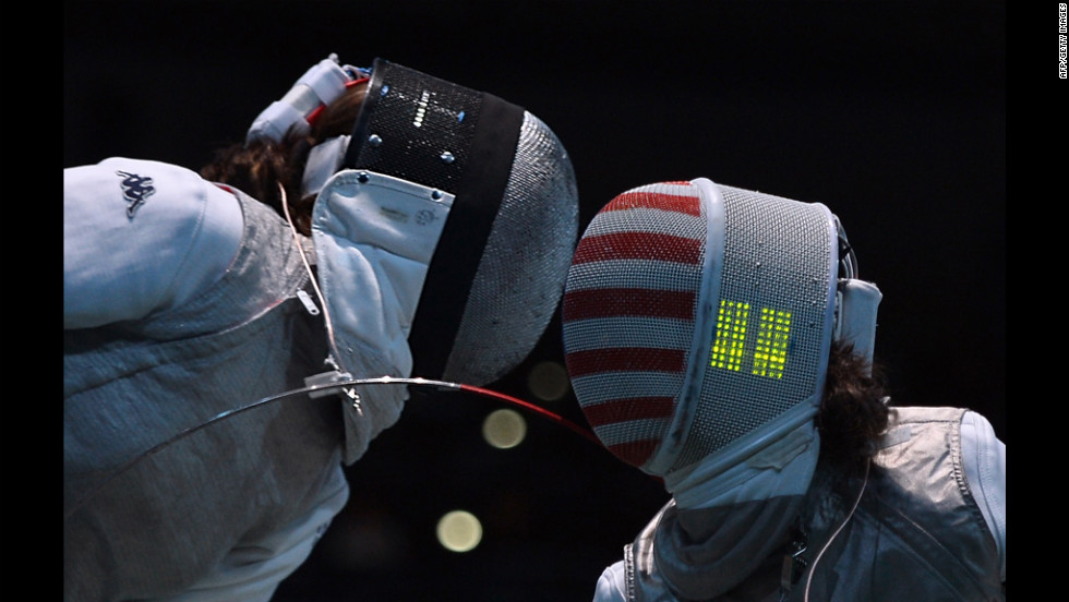 Italy's Arianna Errigo, left, fences against U.S. fencer Lee Kiefer during their women's foil fencing quarterfinal bout.
