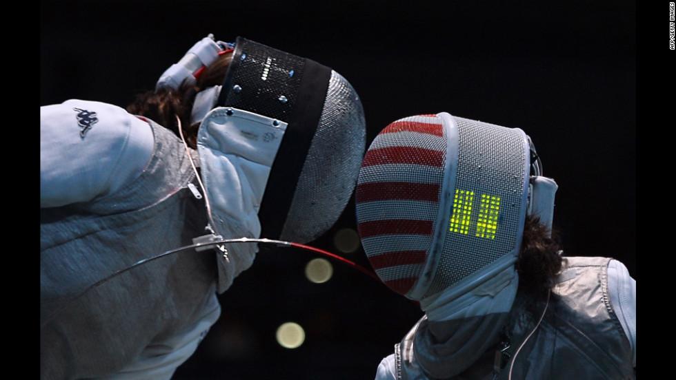 Italy's Arianna Errigo, left, fences against U.S. fencer Lee Kiefer during their women's foil fencing quarterfinal bout.