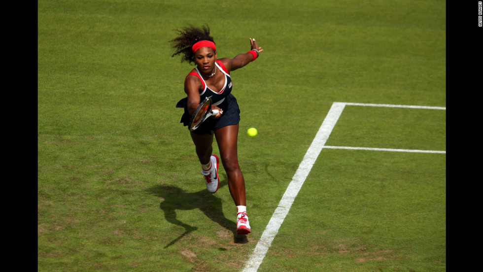 U.S. tennis player Serena Williams returns a shot against Jelena Jankovic of Serbia during their women's singles tennis match.