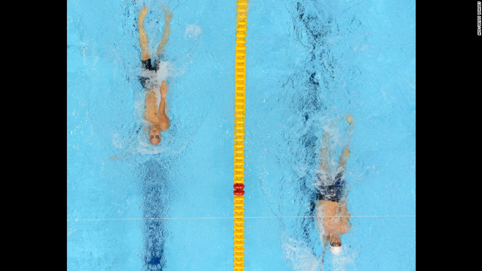 U.S. swimmer Michael Phelps, right, and Hungary's Laszlo Cseh compete in the men's 400 meter individual medley heats.