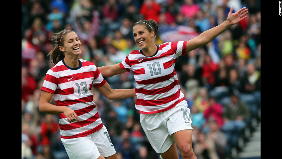 U.S soccer player Carli Lloyd, No.10, and teammate Alex Morgan, No.13, celebrate after scoring their third goal during a first-round game against Colombia.