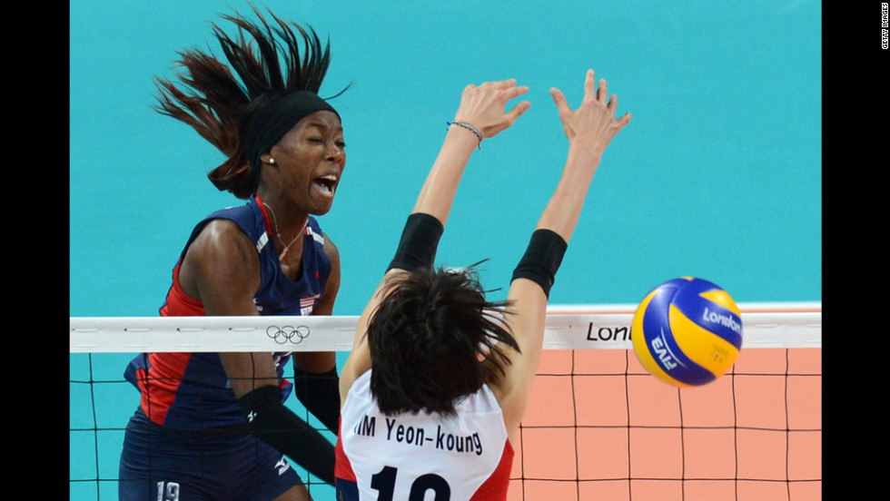 U.S. volleyball player Destinee Hooker, left, spikes as South Korea's Kim Yeon-Koung attempts to block in the women's volleyball match.