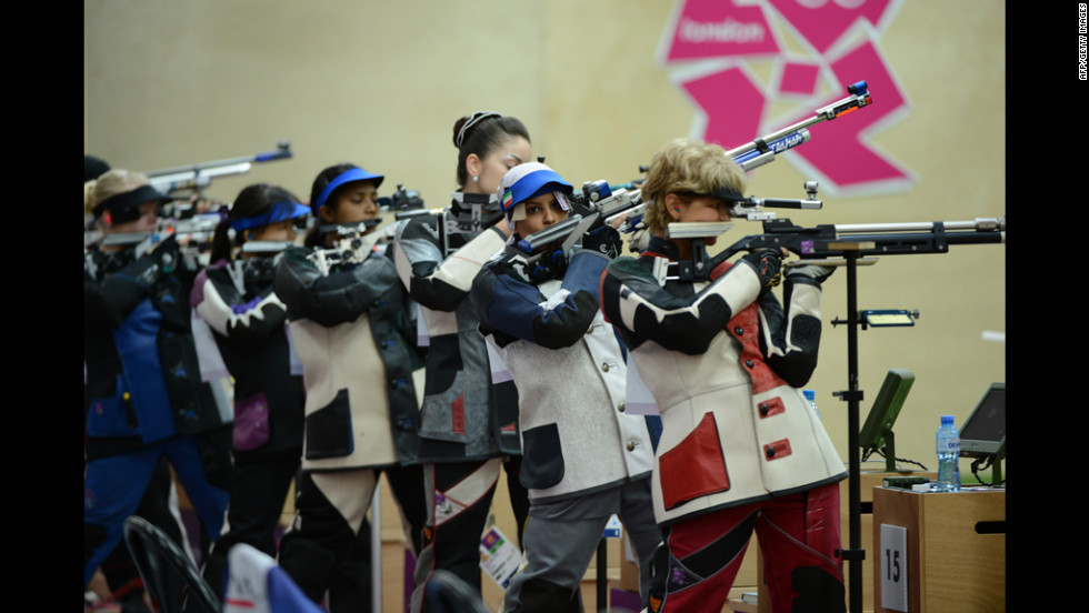 Iran's Elaheh Ahmadi, second from right, competes during the women's 10-meter air rifle qualification at the Royal Artillery Barracks.