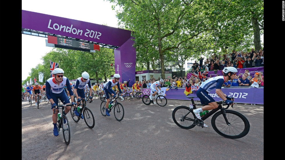 Mark Cavendish of Britain, right, takes off at the start of men's road race cycle event.