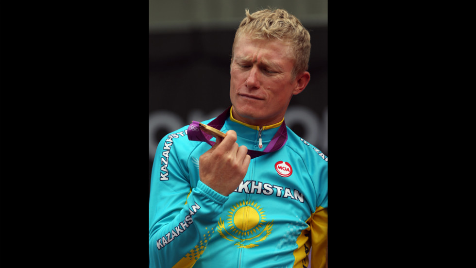 Alexandr Vinokurov of Kazakhstan celebrates in classic Russian existentialist fashion after winning gold.
