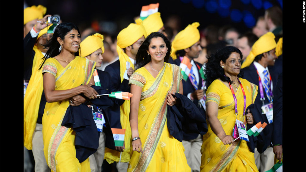 Members of India's delegation parade in the opening ceremony.