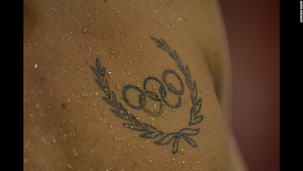 An athlete's Olympic rings tattoo is seen during a swimming event.