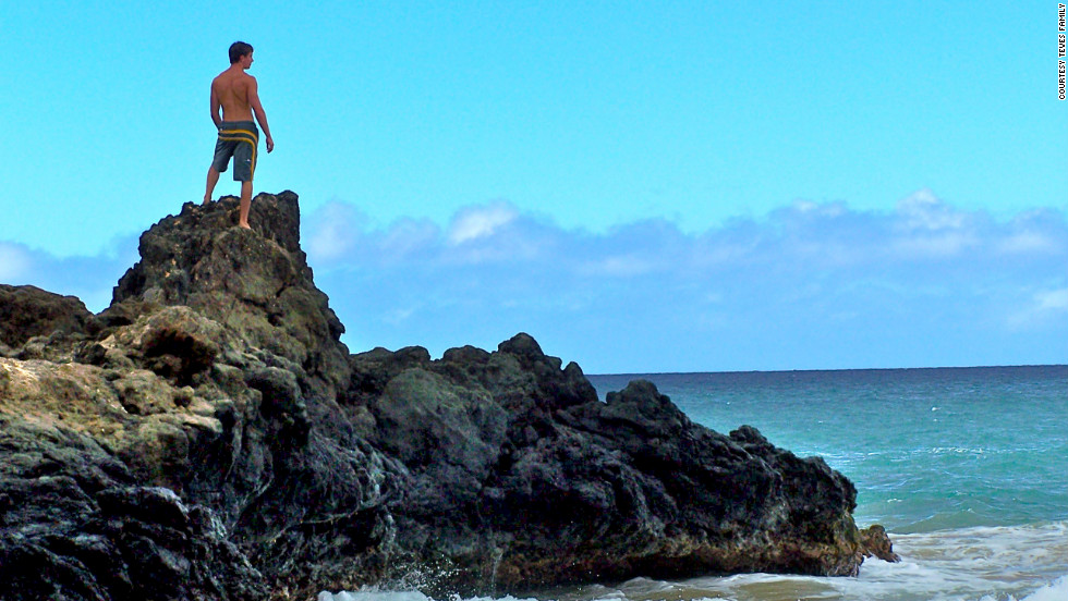 "Alex Teves looks out on a beach in Hawaii a few years ago. He was one of the 12 people killed in the July 20 theater shooting in Aurora, Colorado. ""I took this photo without Alex's knowledge on a secluded beach on Maui,"" says his mother, Caren Teves. ""I love how he seems reflective, and I will always view this photo as him looking over us."""