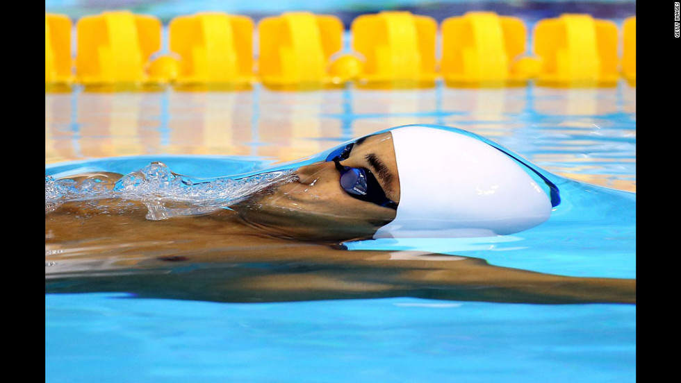 Sri Lanka's Heshan Unamboowe competes in the men's 100-meter backstroke heat.