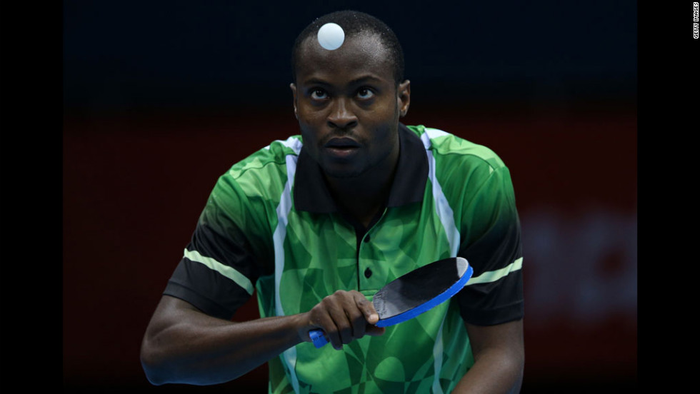 Nigeria's Quadri Aruna serves in his men's singles second-round table-tennis match against Turkey's Bora Vang.