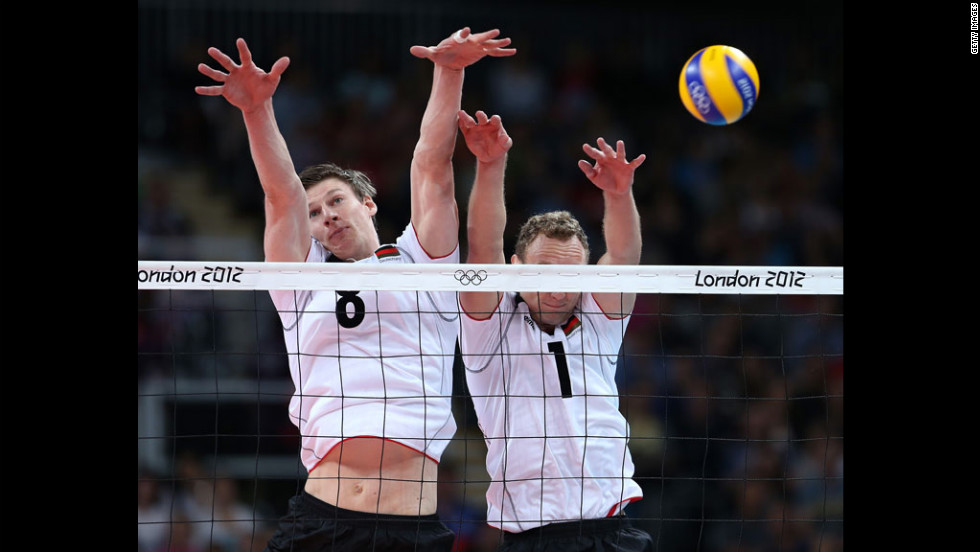 Germany's Marcus Bohme, left, and Marcus Popp attempt to block a shot from Russia during men's volleyball competition.