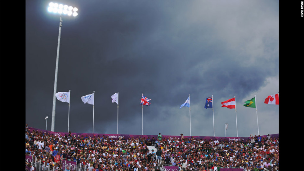 Dark skies loom during the men's beach volleyball preliminary match between Brazil and Austria at the Horse Guards Parade in London.