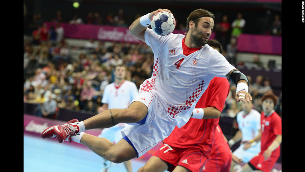 Center back Ivano Balic of Croatia jumps to shoot during a men's preliminary handball against South Korea.