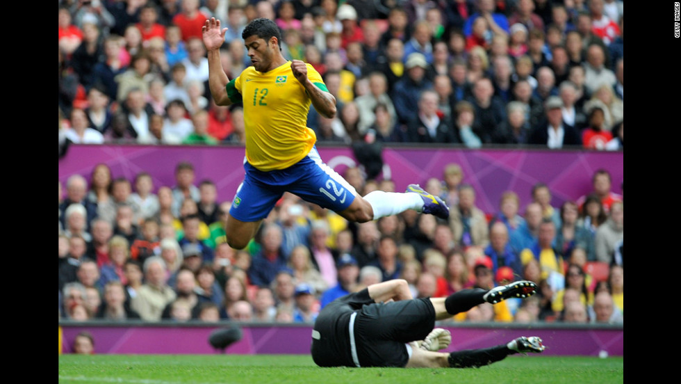 Brazil's Hulk leaps over Aleksandr Gutor of Belarus during a first-round group C football match in Manchester.