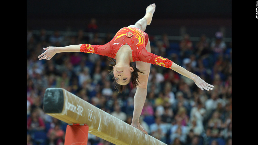 Chinese gymnast Yao Jinnan performs on the beam during the women's artistic gymnastics qualification round.