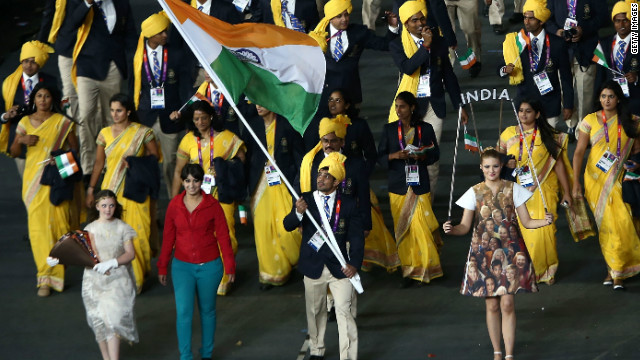 The mystery woman is seen next to Sushil Kumar, as he carries India's flag during the Olympic opening ceremony in  London Friday.
