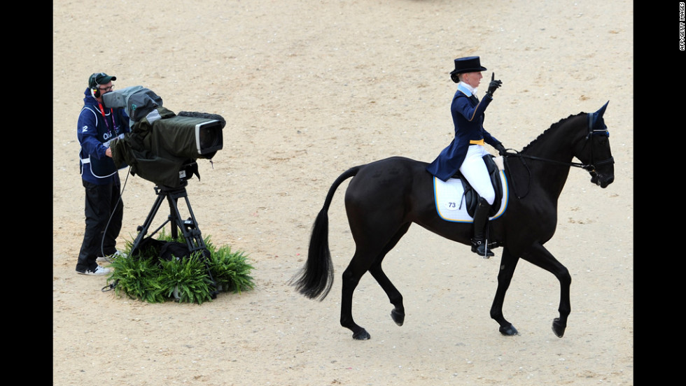 Sweden's Malin Petersen on Sofarsogood acknowledges the crowd after competing in the dressage event.