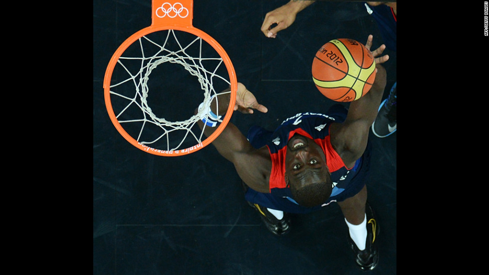 British forward Pops Mensah-Bonsu shoots during the men's preliminary basketball match against Russia.