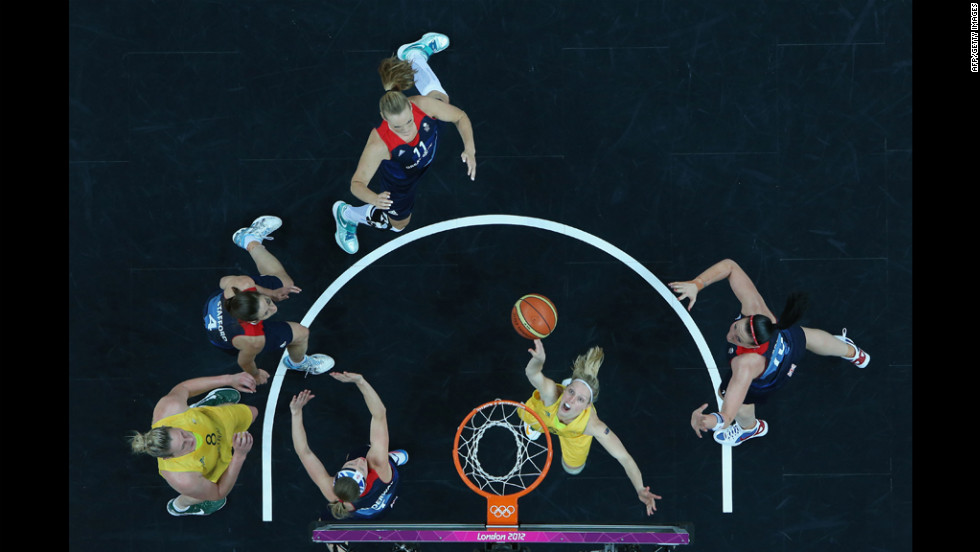 Australia's Samantha Richards, center, shoots a layup against Great Britain during women's basketball play.
