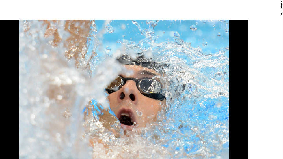 """U.S. swimmer Michael Phelps competes in the men's 400-meter individual medley final swimming event during the first day of Olympics competition in London on Saturday, July 28. Phelps failed to medal in the event, finishing fourth. <a href=""""http://www.cnn.com/2012/07/27/worldsport/gallery/olympic-opening-ceremony/index.html"""">Photos: The opening ceremony</a>"""