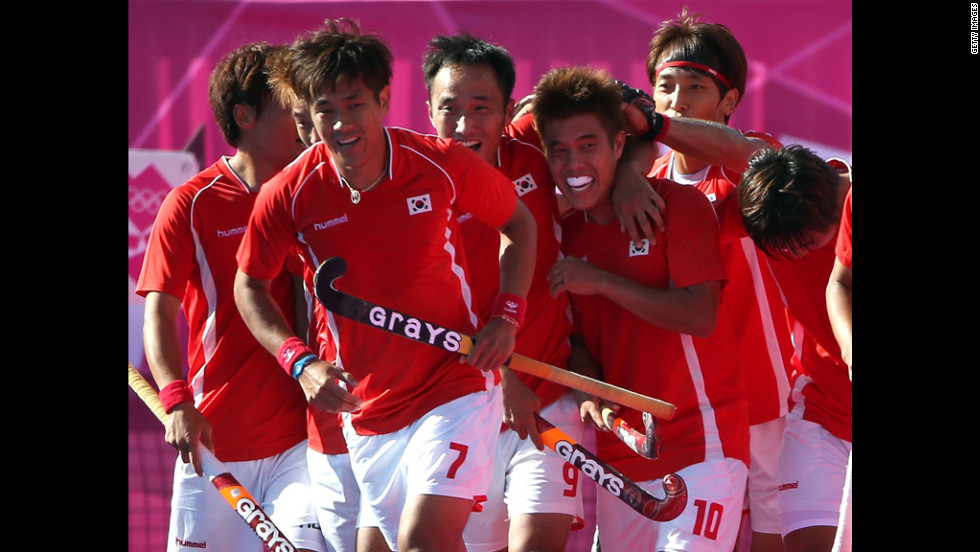 The South Korea men's field hockey team celebrates after scoring a goal against New Zealand during a preliminary match Monday.