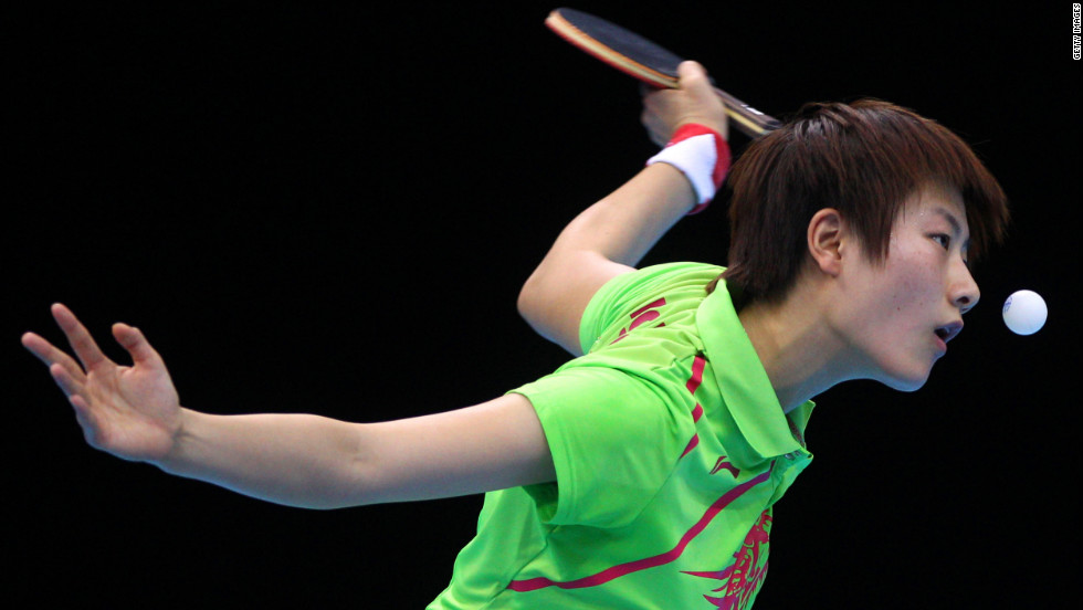 Ning Ding of China eyes the ball during her women's singles table tennis fourth-round match against Huajun Jiang of Hong Kong on Monday.