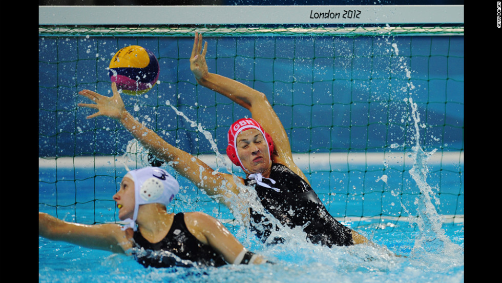 Rosie Morris of Great Britain fails to stop a Russian goal during a women's water polo preliminary match on Monday.