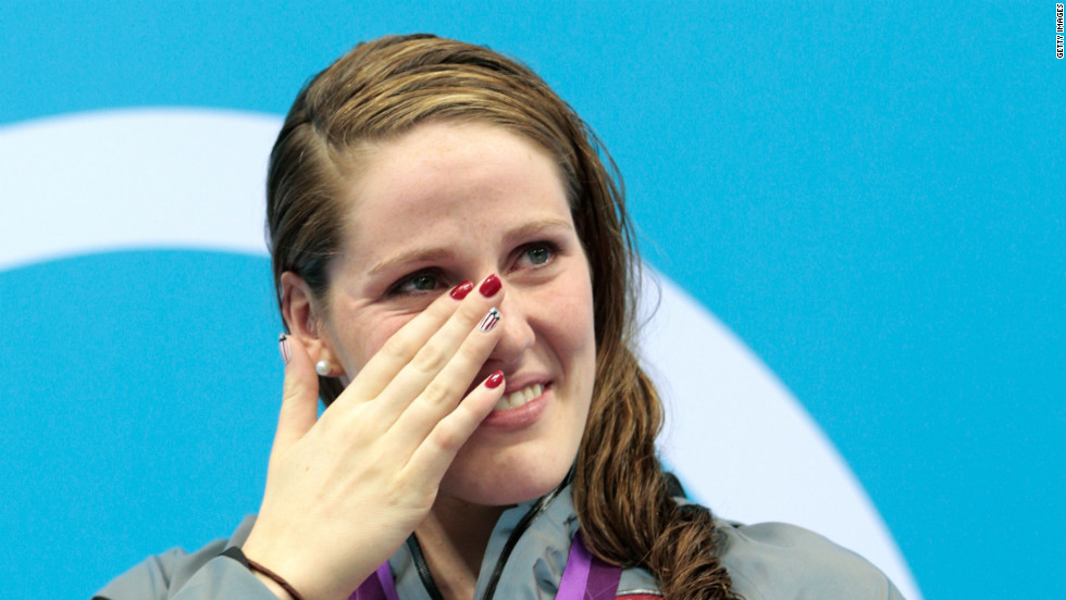 Missy Franklin of the United States wipes a tear as she reacts during the medal ceremony for the women's 100-meter backstroke.