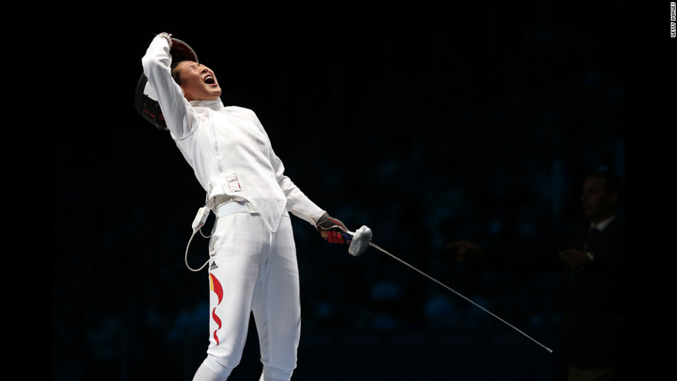 Yujie Sun of China celebrates after defeating A Lam Shin of South Korea to win the bronze medal bout in the women's epee individual fencing competition.