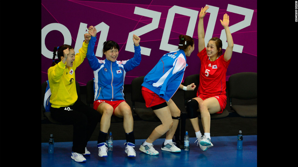 Members of the South Korean women's handball team celebrate after a goal during the preliminary match against Denmark on Monday.