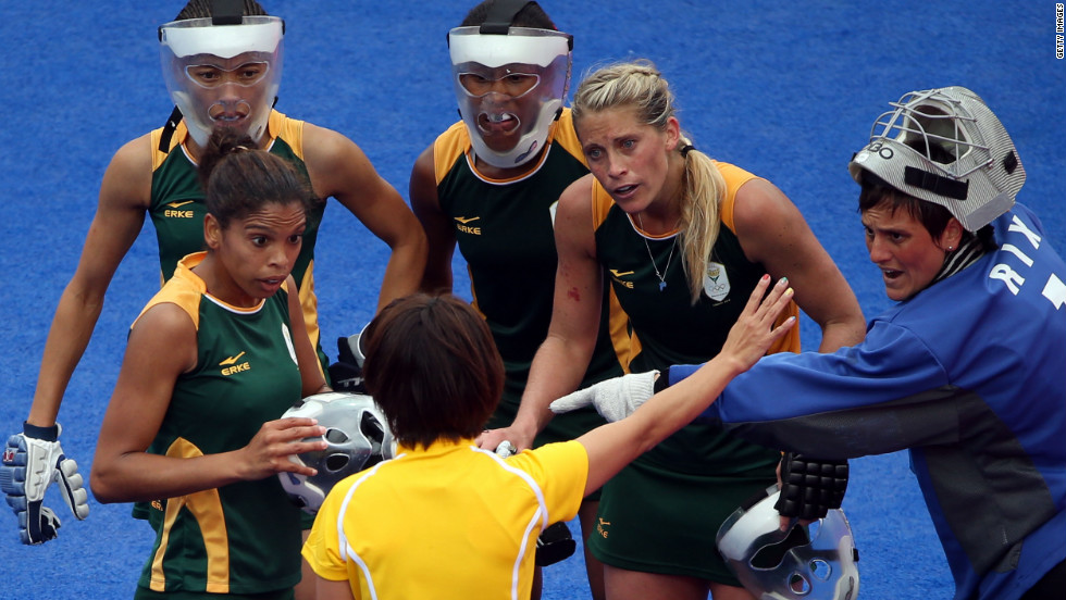 Members of the South African women's field hockey team protest to the referee during a match against New Zealand on Tuesday.