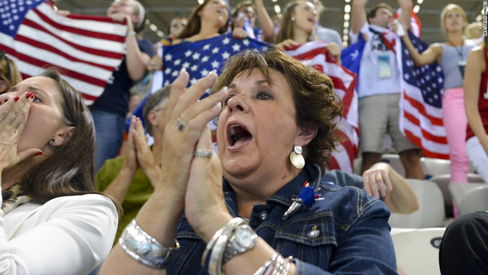 U.S. swimmer Michael Phelps' mother, Debbie, cheers as her son competes in the men's 200-meter backstroke final.
