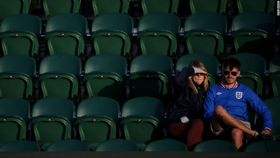 Spectators watch the action on Monday at the All England Lawn Tennis and Croquet Club in Wimbledon.