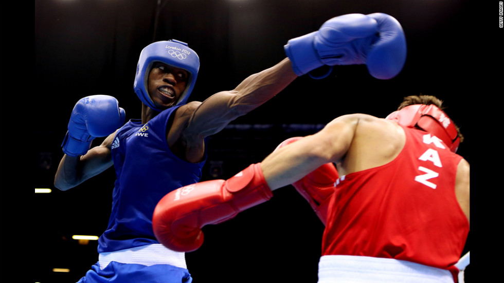 Salomo Ntuve of Sweden (left) in action with Ilyas Suleimenov of Kazakhstan during their men's fly boxing match.