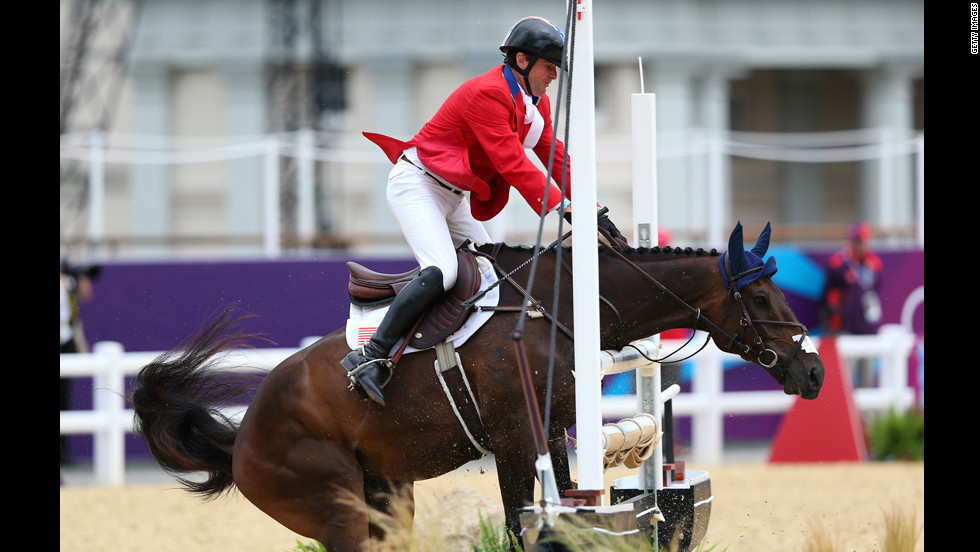 American Phillip Dutton riding Mystery Whisper balks at a jump in the show jumping equestrian event Tuesday.