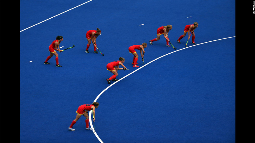 The Belgian team lines around the D for a penalty corner during their women's field hockey match against China.