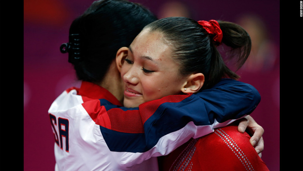 American Kyla Ross and coach Jenny Zhang hug during the women's gymnastics team final Tuesday.