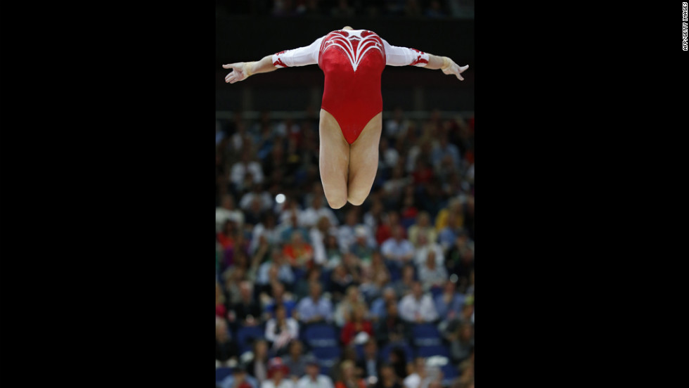 Russia's gymnast Viktoria Komova performs on the beam during the women's team final of the gymnastics event.