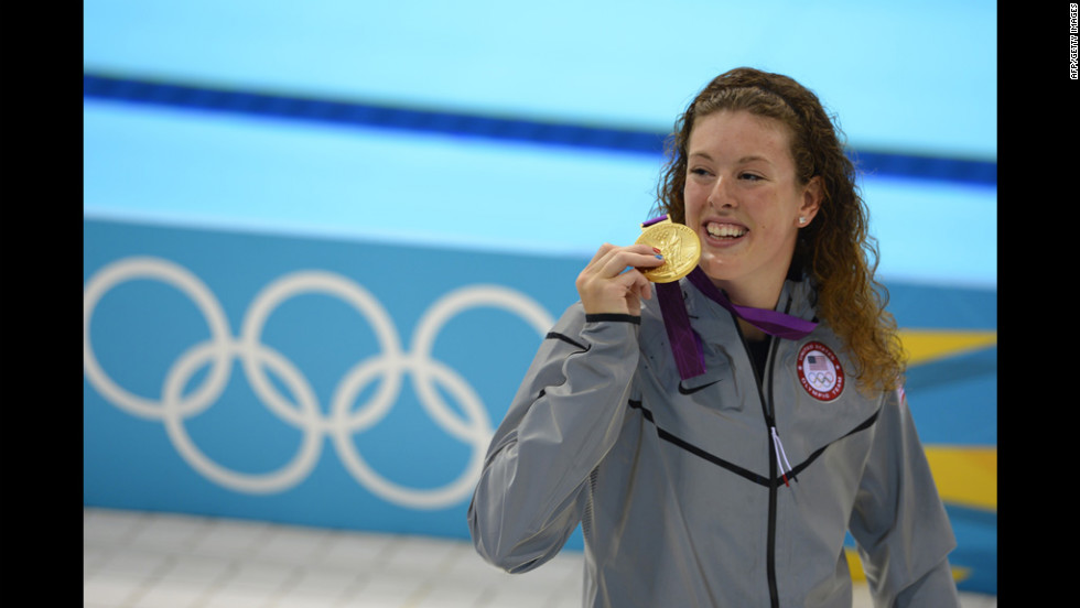 Gold medalist U.S. swimmer Allison Schmitt stands on the podium after the women's 200-meter freestyle final.