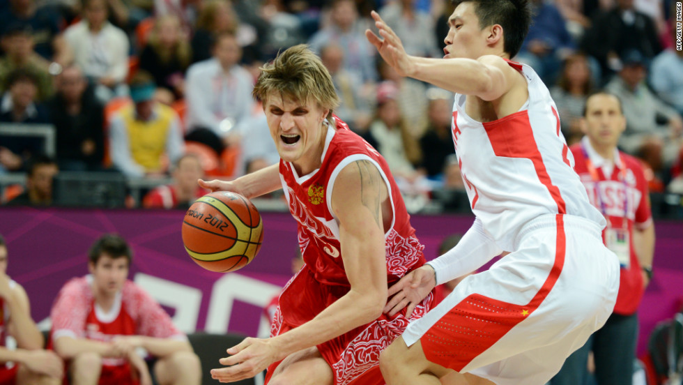 Chinese forward Zhou Peng, right, guards Russian forward Andrei Kirilenko during the men's preliminary round basketball game Tuesday.