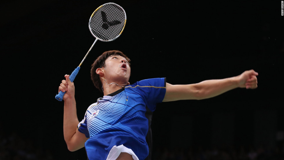 Yong Dae Lee of South Korea takes aim during a mixed doubles badminton match Tuesday.