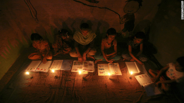 Image #: 18779713    Muslim girls study in the light of candles inside a madrasa or religious school during power-cut in Noida on the outskirts of New Delhi July 30, 2012. Grid failure left more than 300 million people without power in New Delhi and much of northern India for hours on Monday in the worst blackout for more than a decade, highlighting chronic infrastructure woes holding back Asia's third-largest economy. REUTERS/Parivartan Sharma (INDIA - Tags: EDUCATION SOCIETY ENERGY RELIGION)       REUTERS /PARIVARTAN SHARMA /LANDOV