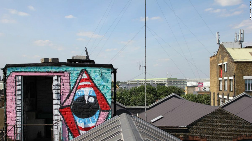 "Hackney Wick rooftops. Sweet Toof and Paul insect can be seen in the foreground.  Sweet Toof and Cylops in the distance. Paul Insect is most famous for his 2007 exhibition ""Bullion,"" which was snapped up by Damien Hirst before it opened."