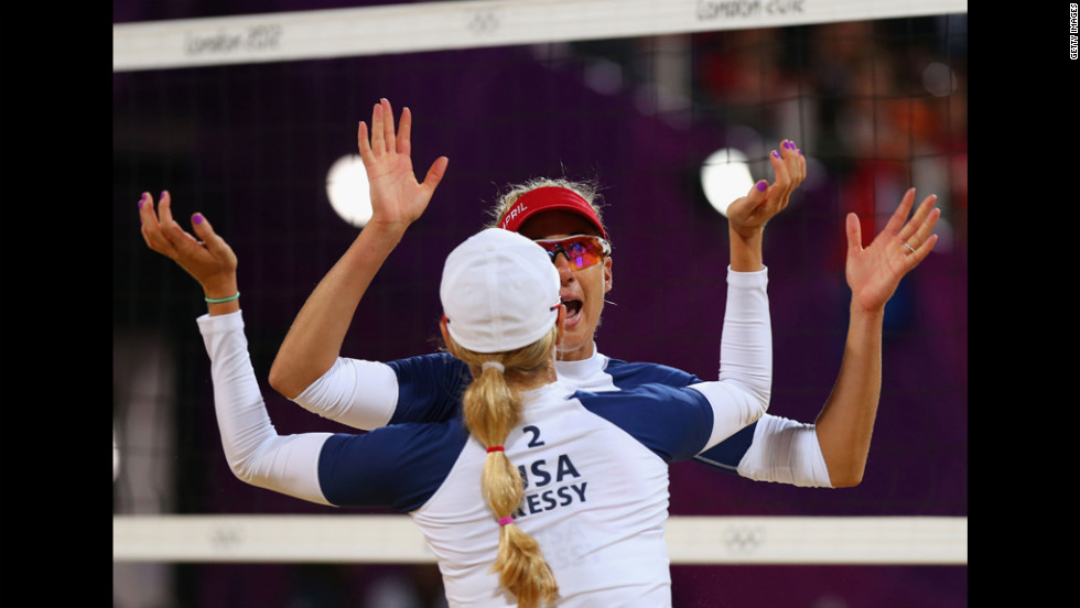 April Ross and Jennifer Kessy of the United States celebrate a point during the women's beach volleyball preliminary match against the Netherlands.