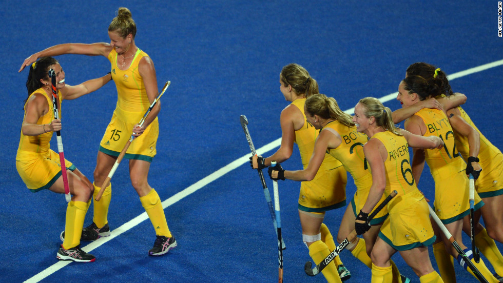 Australian players celebrate a goal during the preliminary round women's field hockey match against Germany.